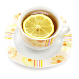 Cup of tea with lemon. On white Royalty Free Stock Images