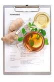 Cup of tea with lemon and anamnesis Royalty Free Stock Photo