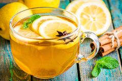 Cup of tea with lemon and anise Stock Photos