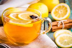 Cup of tea with lemon and anise Royalty Free Stock Photography