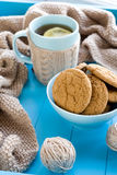 A cup of tea with lemon, biscuits, beige knitted blanket Royalty Free Stock Photos