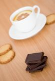 Cup of tea with lemon, biscuits and chocolate Stock Photos