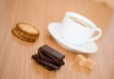 Cup of tea with lemon, biscuits and chocolate Stock Photo
