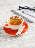 Cup of tea with lemon, biscuits and an open blank notebook Royalty Free Stock Photography
