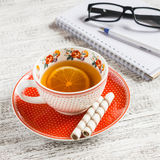 Cup of tea with lemon, biscuits and an open blank notebook Royalty Free Stock Images