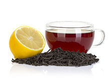 Cup of tea with lemon and black tea isolated on white Royalty Free Stock Photo