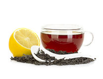 Cup of tea with lemon and black tea isolated on white Royalty Free Stock Photos