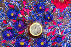 Cup of tea with lemon with blue flowers Stock Photography
