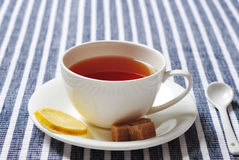 Cup with tea and lemon Royalty Free Stock Photo