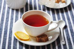 Cup with tea and lemon Royalty Free Stock Photography