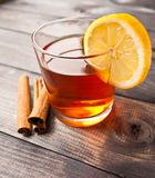 Cup of tea with lemon and cinnamon Royalty Free Stock Photo