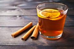 Cup of tea with lemon and cinnamon Stock Photos