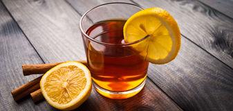 Cup of tea with lemon and cinnamon Royalty Free Stock Images