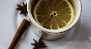 A cup of tea with lemon. And cinnamon and onyx Royalty Free Stock Images