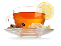 Cup of tea with lemon, cinnamon and sugar Stock Photos