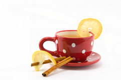 Cup of tea with lemon and cinnamon. On  white background Royalty Free Stock Photography