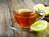 A cup of tea and a lemon. Close-up Stock Images