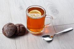 Cup of tea with lemon and cookies on a wooden table Stock Photography