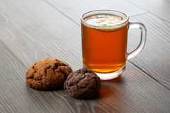 Cup of tea with lemon and cookies on a wooden table Royalty Free Stock Image