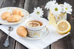 Cup of tea with lemon and croissant Royalty Free Stock Image