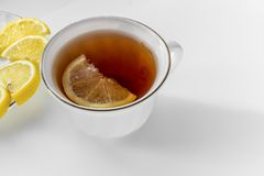Cup of tea with lemon. On white background stock images
