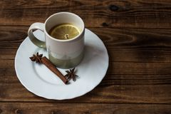 A cup of tea with lemon. On wooden background Stock Images