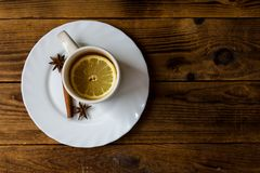 A cup of tea with lemon. On wooden background Stock Photo