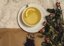 A cup of tea with a lemon stock images