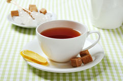 Cup with tea and lemon Stock Photos