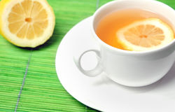 Cup of tea with lemon Stock Images