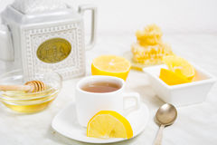 A cup of tea with lemon and honey Stock Photos