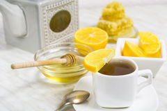 A cup of tea with lemon and honey Royalty Free Stock Photo