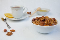 Cup of tea with lemon, honey and nuts. Cup of tea with lemon, honey,  nuts conisit of walnut, hazelnut and almond and sugar Stock Photography
