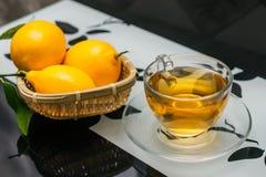 Cup of tea  and lemon Stock Photos