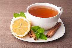 Cup of tea with lemon and mint Royalty Free Stock Photography