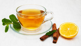 Cup of tea with lemon and mint. On a old white wooden background Royalty Free Stock Photo
