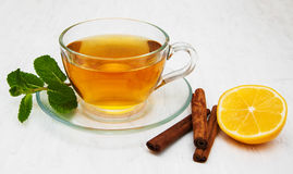 Cup of tea with lemon and mint Royalty Free Stock Image