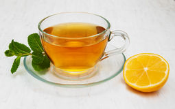 Cup of tea with lemon and mint Stock Photos