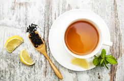 Cup of tea with lemon and mint Stock Photo