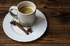 A cup of tea with lemon. And onyx cinnamon Royalty Free Stock Photo