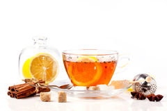 Cup of tea with lemon over white Royalty Free Stock Photos