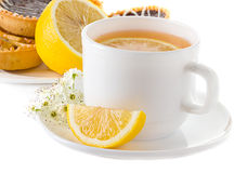 Cup of tea with lemon and pastries Stock Photo