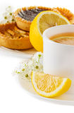 Cup of tea with lemon and pastries Stock Images