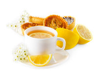 Cup of tea with lemon and pastries Royalty Free Stock Images