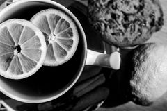 A cup of tea with lemon pieces - black and white. Stock Image