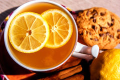 A cup of tea with lemon pieces. Stock Photography