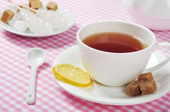 Cup with tea and lemon Stock Photo