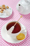 Cup with tea and lemon Stock Images