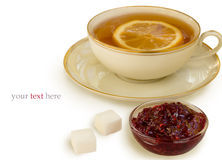 Cup of tea with lemon and raspberry jam Royalty Free Stock Image