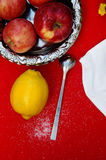 A cup of tea, lemon on a red background, food and drink, knife and fork, tea time, breakfast time view from above, cup of coffe, r. Ed apples , a bouquet of Royalty Free Stock Images